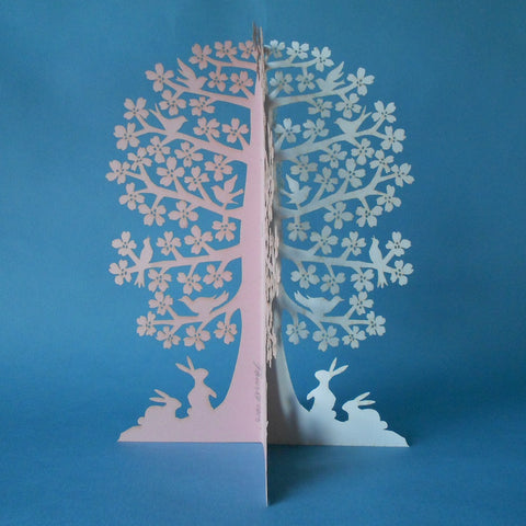 Papercut Dogwood Tree ornament with birds and rabbits by Judith Meyers