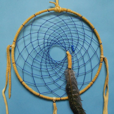Victor Godines, a resident of the Warm Springs Reservation of Oregon, created this 12-inch dreamcatcher with a blue web and beads and gray turkey feathers.