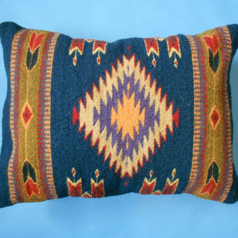 "Oregon weaver Francisco Bautista wove this pillow cover featuring the Zapotec ""Eye of God"" design as well as Quetzalcoatl imagery."