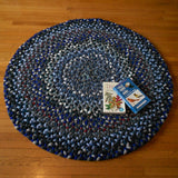Round hand braided rug made from Pendleton fabrics in a rich blue mix.