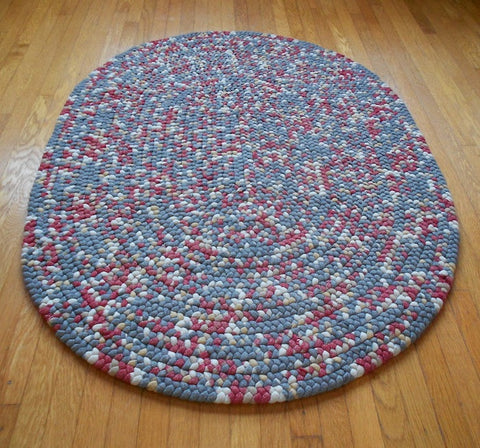 This hand braided wool rug was made using strips of Pendleton flannel shirt fabric.