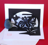 This pop-up card by Kyoko Niikuni is really a small paper kiri-e sculpture of a hummingbird drinking from an iris bloom.