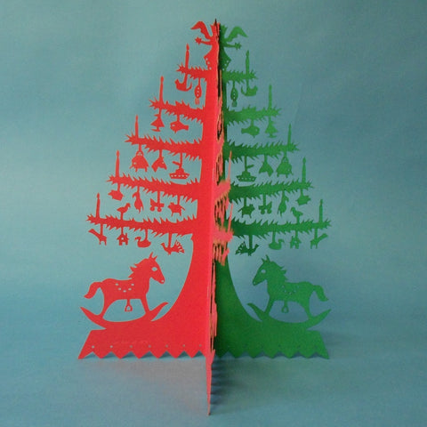 This Rocking Horse Papercut Tree by Judith Meyers is decorated with a variety of Victorian-style ornaments.