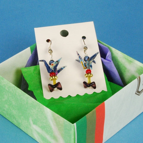 Pacific Northwest artist Kyoko Niikuni designed these earrings around blue patterned origami cranes that she created.