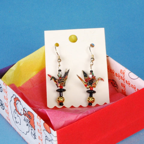 Pacific Northwest washi artist Kyoko Niikuni designed these earrings around tiny origami cranes that she created with red and black patterned paper.