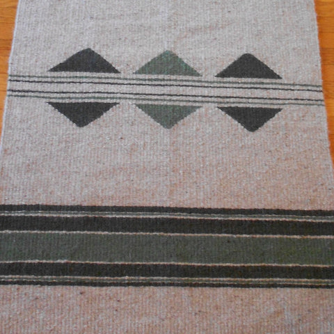 This is a detail of the handwoven Navajo-Churro wool rug with stripes and a split diamond shape by Linda Morton-Keithley of Idaho.