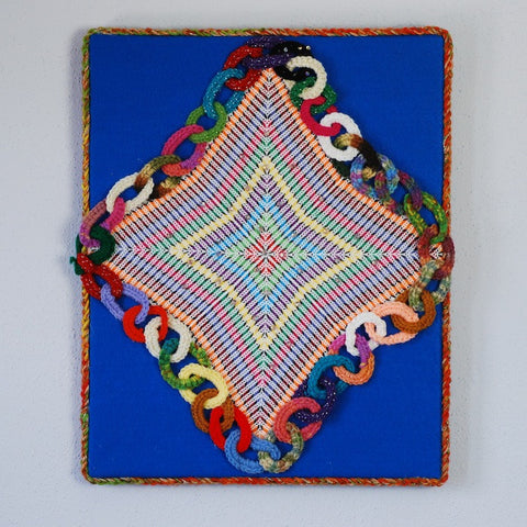 "In her textile piece ""Mi Amanecer"" or ""My Sunrise,"" Rita Flores de Wallace uses the technique of ""magic embroidery"" to evoke the colors of the sunrise."
