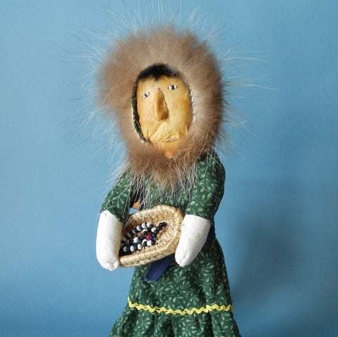 This Native Alaskan Woman with Berry Basket Doll is made by accomplished doll maker Annie Hurlbut and includes a handmade beach grass basket.
