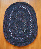 Dark gray and sky blue hand braided wool rug sized 31 in x 23 in