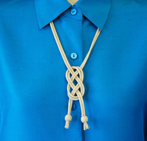 This braided rawhide necklace by Mike Alley of Wyoming features a central alamar knot.