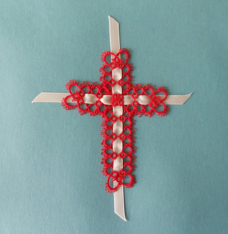 This tatted cross bookmark was created with red cotton thread and a white ribbon.