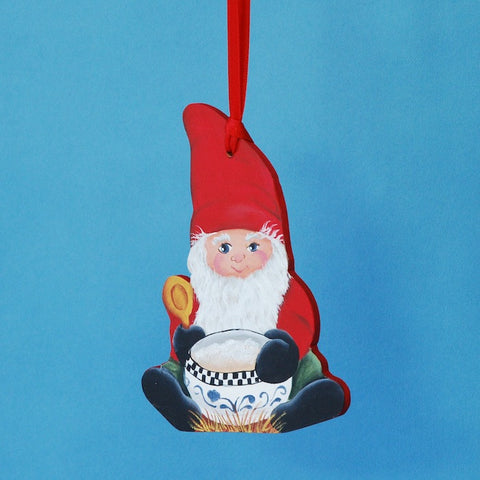 The artist uses her Scandinavian rosemaling techniques to paint this wooden Christmas ornament of a tomte figure holding a bowl of porridge.