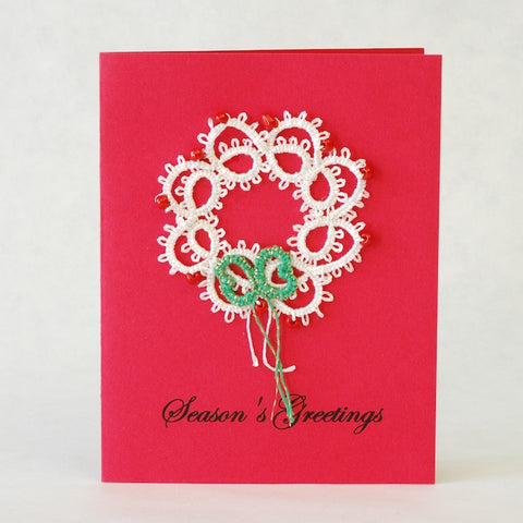 Mary Maynard of Wyoming hand tatted the white wreath that she placed on this red holiday card.