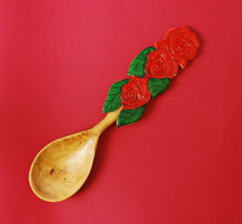 Phil Lengelbach of Oregon has used pear wood to carve the spoon pictured here in the Triple Rose design.
