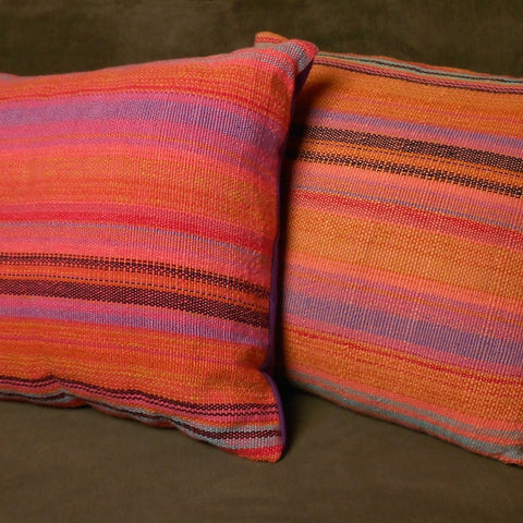 Two handwoven pillows woven by Georgia Wier from yarns handspun and dyed by women in Africa.