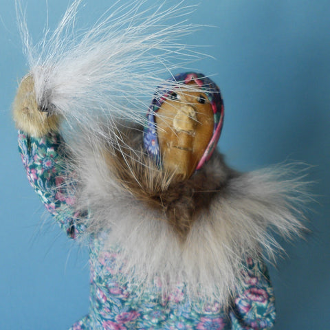This Woman Dancer Doll was created by Ursula Paniyak-Irwin to show a woman of her region in Alaska performing a Yu'pik fan dance.