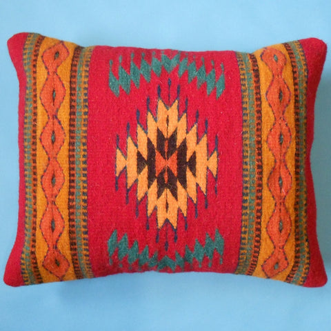 "Oregon weaver Francisco Bautista created this pillow featuring the ""Eye of God"" design on a red background."