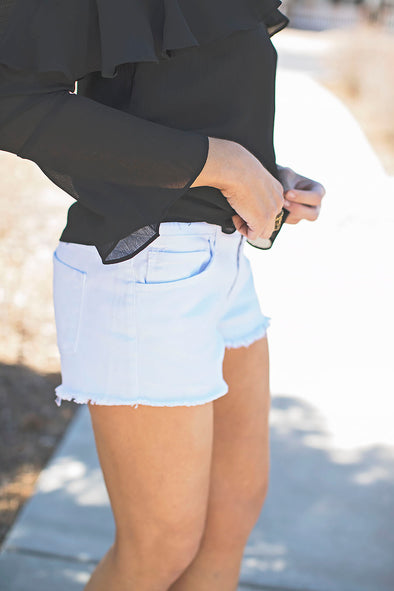 White fray denim shorts