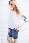 Embroidered off shoulder blue top