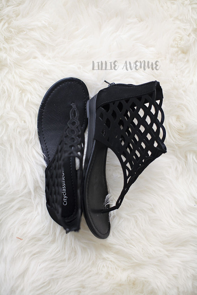 Cutout flat sandals in black