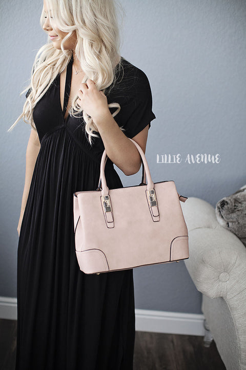 Light pink purse and extra small bag