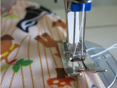 Twin needle utilized in the making of a baby's bib.