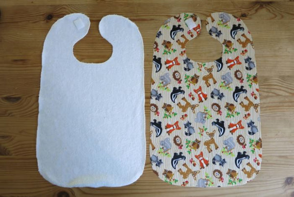 Both sides of fabric for crafting a baby bib.