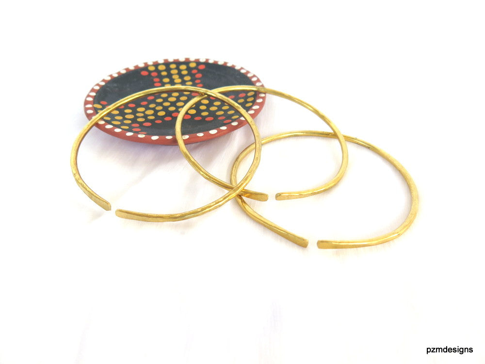 Thick gold bangles, set of three artisan made bangle bracelets