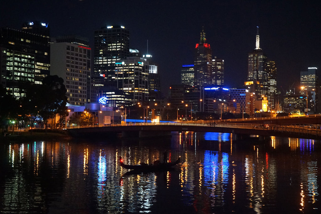 MINUTIAE of Melbourne. City skyline provides a backdrop for the Yarra river. Minutiae: the small precise details that make one unique. Luxury leather bags and accessories.
