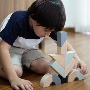 Child playing with Twisted Blocks set by Plan Toys