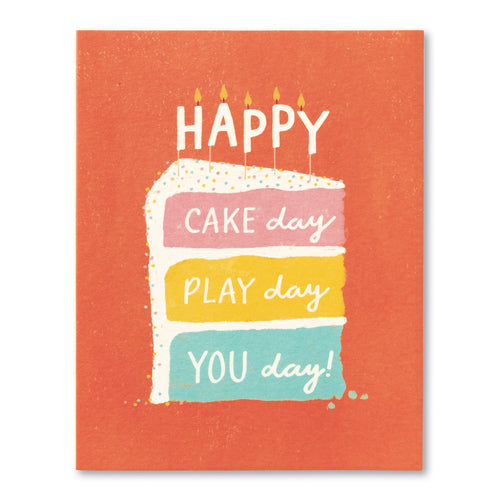 Red birthday card with slice of rainbow cake