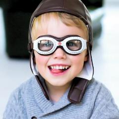 Young boy wearing Baghera goggles and soft helmet