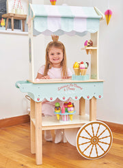 Child playing with Honeybake Treats Trolley Wooden Playset