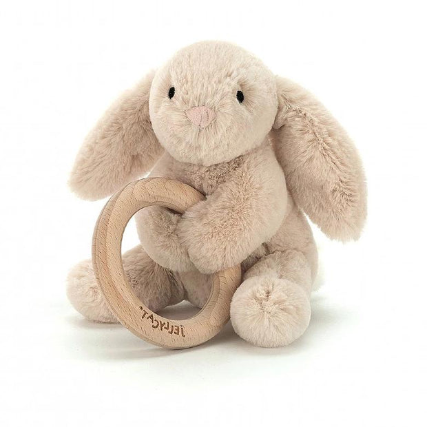 Brown bunny soft toy holding wooden teething ring