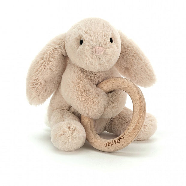 Bunny soft toy holding wooden teething ring