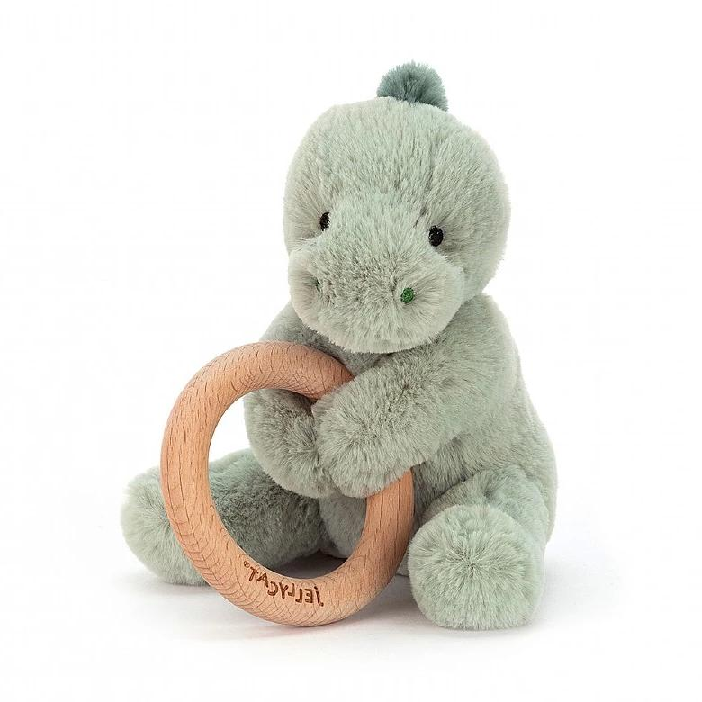 Green dinosaur soft toy attached to wooden teething ring