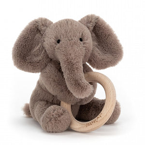Elephant soft toy attached to wooden teething ring