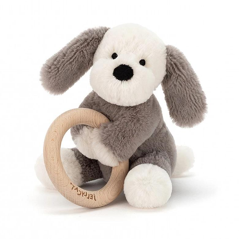 Puppy soft toy holding wooden teething ring