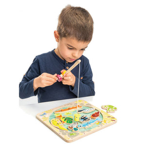 Boy playing with Tender Leaf Toys Pond Dipping Game