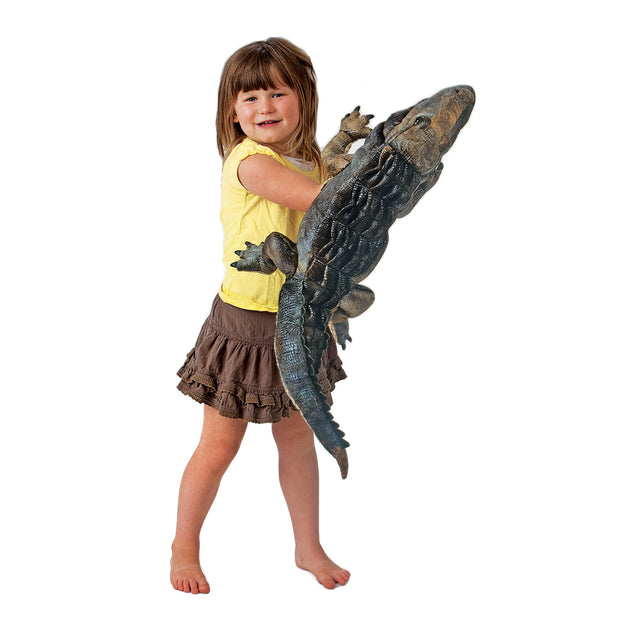 Young girl holding Alligator Hand Puppet -  Folkmanis
