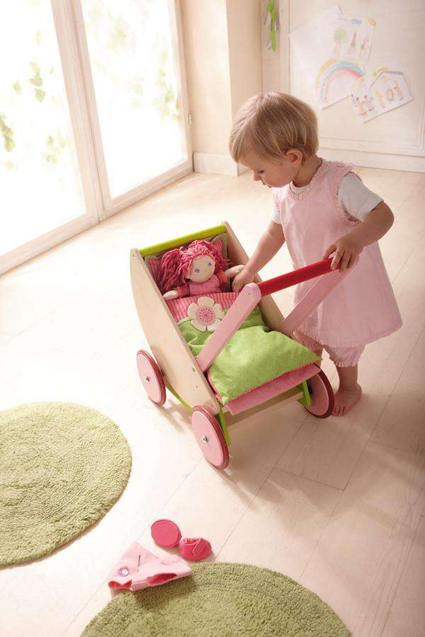 Child playing with Haba 5889 wooden Cherry Blossom Dolls Pram - Send A Toy