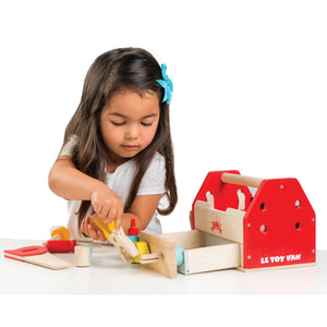Girl playing with Le Toy Van wooden tool box toy
