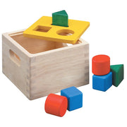 Natural wood shape sorter box with yellow lid and 6 sorting blocks - Plan Toys