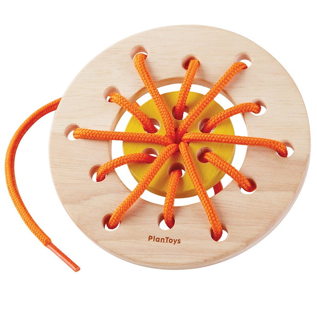 Wooden lacing ring toy with orange thread - Plan Toys 5373