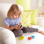 Young girl playing with Rainbow Ball Pegging Game- assembled - Haba