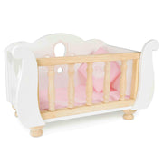White wooden Sleigh Doll Cot with pink bedding