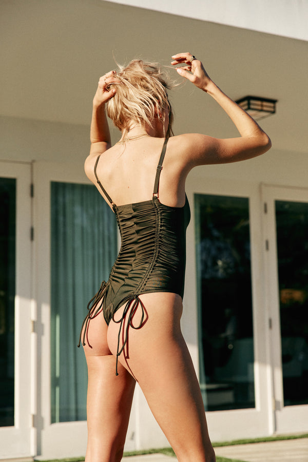 green reversible one piece deep-v lace up suit eco-friendly sustainable
