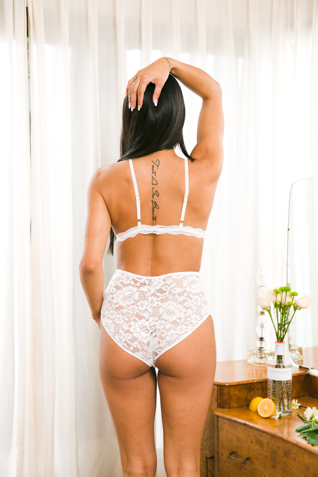HAH's high-waisted, full coverage bottom is made of sexy, stretch lace. These panties are the perfect addition to a lingerie set or under a feminine dress.