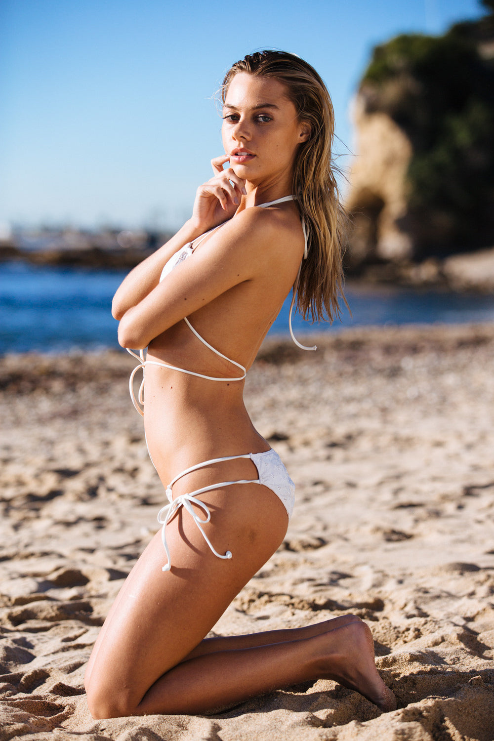 white eyelet vintage inspired cheeky bikini bottom with side ties | Model is wearing S