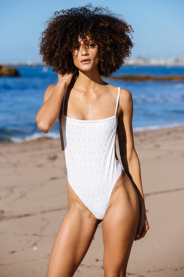 white eyelet one piece vintage inspired open back bottom moderate coverage eco-friendly sustainable